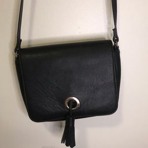 Black crossbody bag with tassels